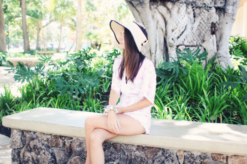 Ana Free in Waikiki, Hawaii wearing floral romper and straw folding hat! - thecasualfree.com