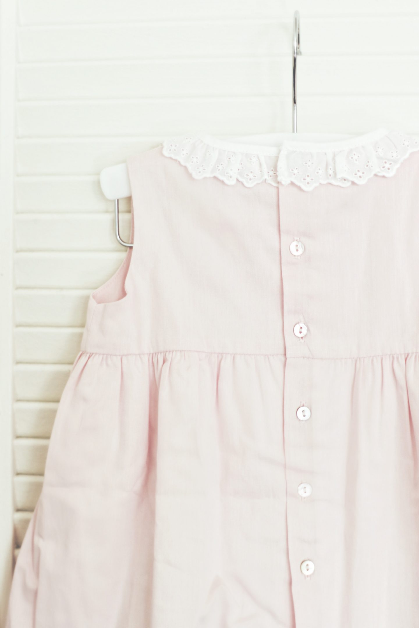 Cute Blush Pink Baby Dress by Laranjinha with button detail! - thecasualfree.com