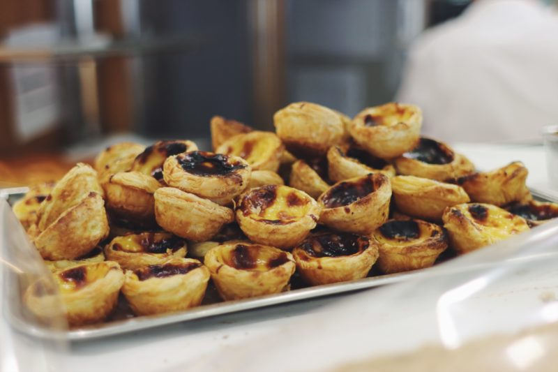 Where To Eat in Cascais, Portugal. Pasteis De Nata custard tarts at the best bakery in Cascais, Portugal at A Sacolinha. Read on for more! - thecasualfree.com