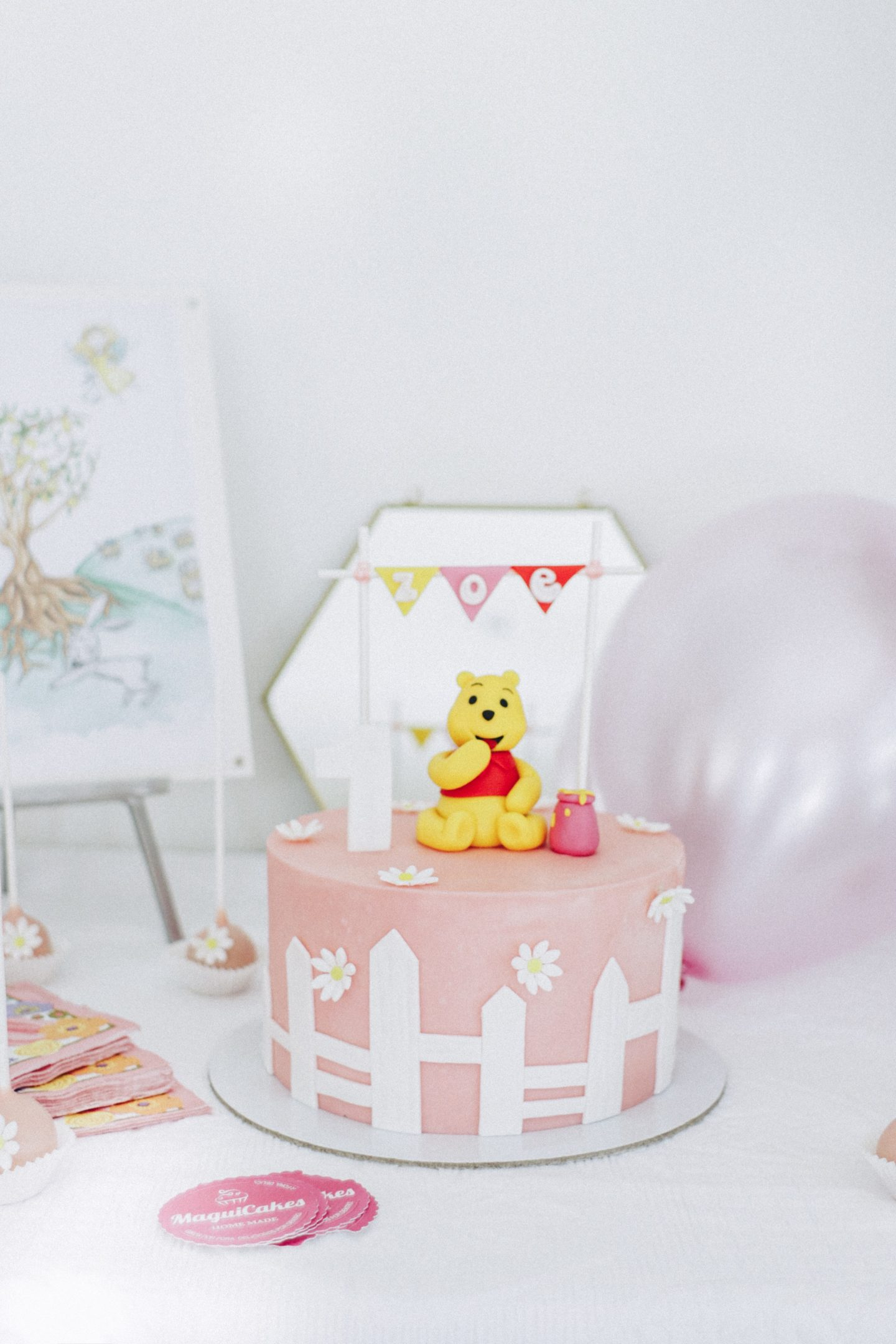 Zoe's First Birthday Party, themed pink, gold and white! Winnie-The-Pooh birthday cake! - thecasualfree.com