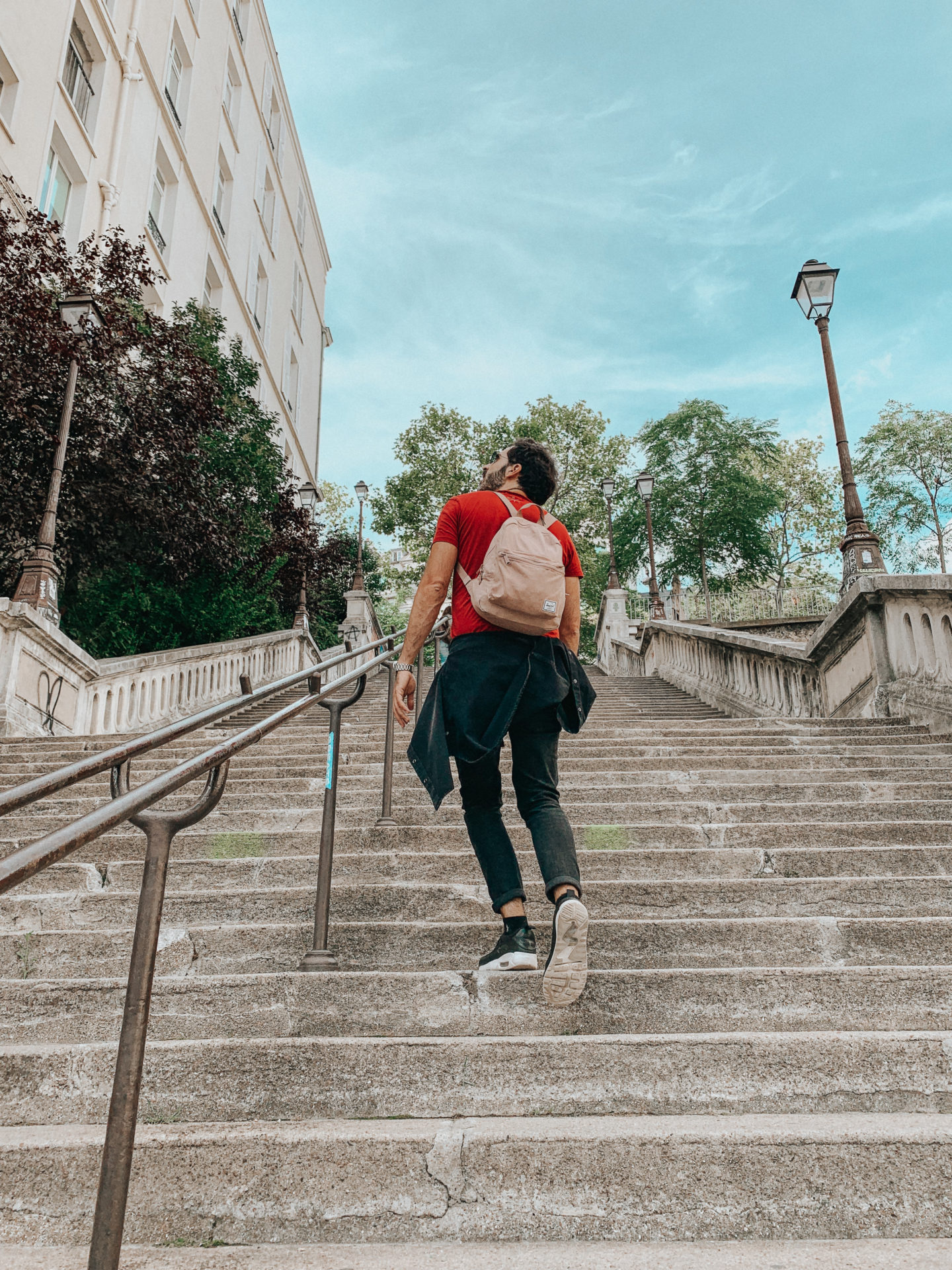 Tourists in Paris on the stairs